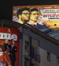 """A banner for """"The Interview""""is posted outside Arclight Cinemas, Wednesday, Dec. 17, 2014, in the Hollywood section of Los Angeles. A U.S. official says North Korea perpetrated the unprecedented act of cyberwarfare against Sony Pictures that exposed tens of thousands of sensitive documents and escalated to threats of terrorist attacks that ultimately drove the studio to cancel all release plans for the film at the heart of the attack, """"The Interview."""" (AP Photo/Damian Dovarganes)"""