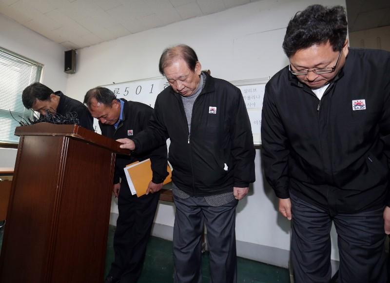 Executives of Sajo Industries bow to families of the missing fishermen of the South Korean fishing boat Oryong 501, which sank in the western Bering Sea on Dec. 1, during a briefing session at the company's branch office in Busan, South Korea, Wednesday, Dec. 3, 2014. (AP Photo/Yonhap, Kim Sun-ho)