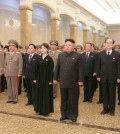 North Korean leader Kim Jong-un (C, front row) pays tribute to the mausoleum of his father Kim Jong-il at the Kumsusan Palace of the Sun in Pyongyang on Dec. 17, 2014, to mark the third anniversary of the senior Kim's death. The mausoleum enshrines the mummified bodies of Kim Jong-il and Kim Il-sung, the current leader's grandfather and the founder of the North Korean government. (KCNA-Yonhap)