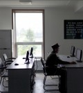 A military officer uses a computer in an electronic library at the Mangyongdae Revolutionary School, an elite military school for boys ages eleven to eighteen, on the outskirts of Pyongyang, North Korea. (AP Photo/Alexander F. Yuan)