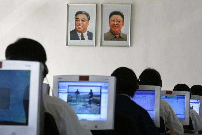 North Korean students use computers in a classroom with portraits of the country's later leaders Kim Il-sung, left, and his son Kim Jong-il hanging on the wall at the Kim Chaek University of Technology in Pyongyang, North Korea. Key North Korean websites were back online Tuesday, Dec. 23, 2014 after an hours-long shutdown that followed a U.S. vow to respond to a cyberattack on Sony Pictures that Washington blames on Pyongyang. (AP Photo/Vincent Yu)