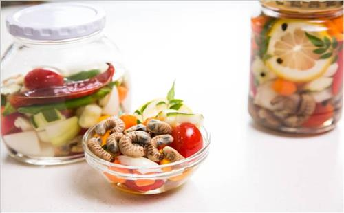 Pickled larva and assorted vegetables (Photo courtesy of 2014 Agribioexpo/Yonhap)