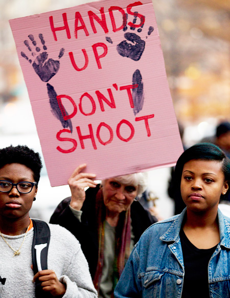 Demonstrators protest against the shooting death of unarmed 18-year-old Michael Brown, during a rally at the Department of Justice in Washington, Monday. (AP)