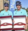 In this photo released by the PNC Father/Son Challenge, the Father/Son Challenge Golf winners Bernhard Langer, right, and son Jason, 14, pose with their first-place trophies in Orlando, Fla., Sunday, Dec. 14, 2014. (AP Photo/ PNC Father/Son Challenge, Geoff Bolte)