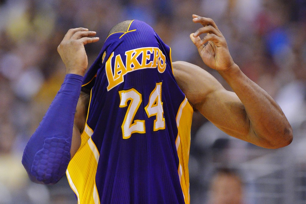 Los Angeles Lakers guard Kobe Bryant probably wanted to do this after hearing what Magic Johnson had to say. (AP)