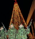 South Korean Marine Corps soldiers stand in front of the Christmas tree at the Kwanghwa Island, west of Seoul near the North Korean border, in December 1996. (AP Photo/Yun Jai-hyoung)