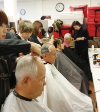Volunteers provide free haircuts to seniors at the Korean American Community Services