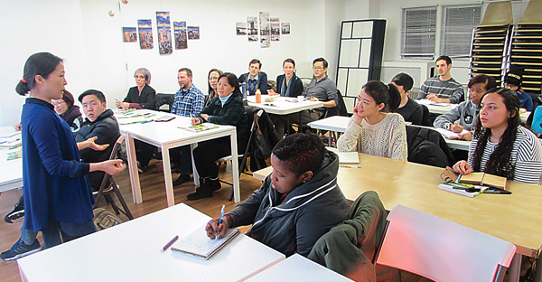 Korean language students at the Korean Cultural Center during a lesson.