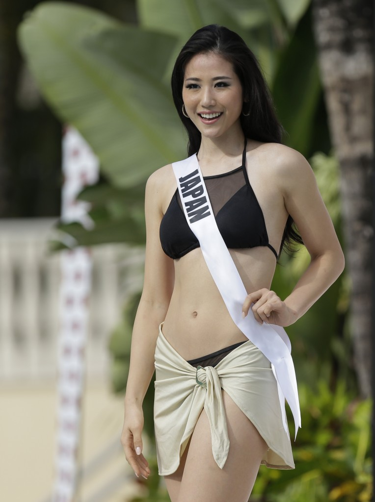 Miss Universe contestant Keiko Tsuji, of Japan, walks along the pool during the Yamamay swimsuit runway show, Wednesday, Jan. 14, 2015, in Doral, Fla. The Miss Universe pageant will be held Jan. 25 in Miami. (AP Photo/Lynne Sladky)