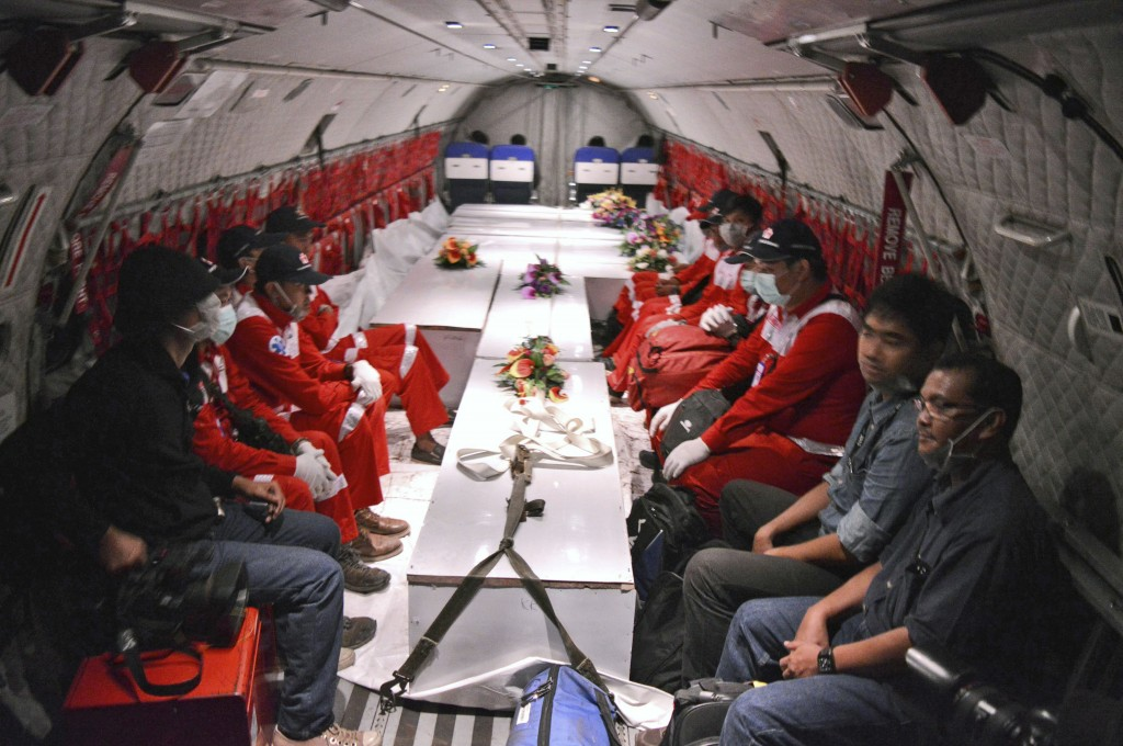 Each of the victim's families will receive $100,000 (1.25 billion rupiah), Sunu Widyatmoko, president of AirAsia Indonesia, told reporters in Surabaya. (AP Photo/Jefri Aries)