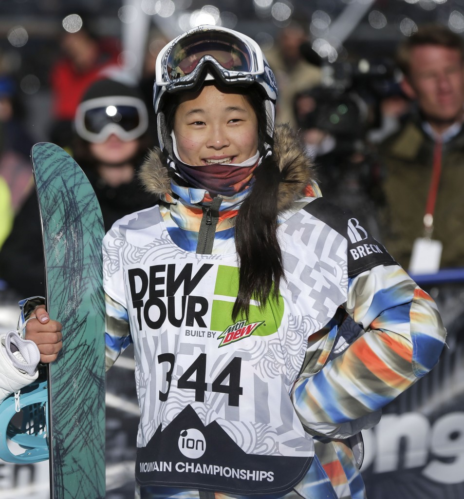 In this Dec. 14, 2013, file photo, Chloe Kim watches the replay of her second run during the snowboarding superpipe final at the Dew Tour iON Mountain Championships in Breckenridge, Colo. Kim took third place in the event. One of the best snowboarders in the world was too young to go to the Sochi Olympics a year ago. So teenager Chloe Kim watched the halfpipe competition from the comfort of her living room while eating popcorn with her family. (AP Photo/Julie Jacobson, File)