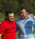 Patrick Reed, left, is congratulated by Jimmy Walker after Reed won a playoff hole to win the Tournament of Champions golf tournament, Monday, Jan. 12, 2015, in Kapalua, Hawaii.  (AP Photo/Marco Garcia)