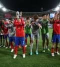 South Korean player acknowledge the crowd after losing the AFC Asian Cup final soccer match between South Korea and Australia in Sydney, Australia, Saturday, Jan. 31, 2015. (AP Photo/Rick Rycroft)