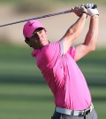 Rory McIlroy of Northern Ireland plays a ball on the16th hole during round two of the Dubai Desert Classic golf tournament in Dubai, United Arab Emirates, Friday, Jan. 30, 2015. (AP Photo/Kamran Jebreili)