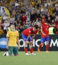 Team Australia celebrates after winning the AFC Asian Cup final soccer match between South Korea and Australia in Sydney, Australia, Saturday, Jan. 31, 2015. (AP Photo/Quentin Jones)