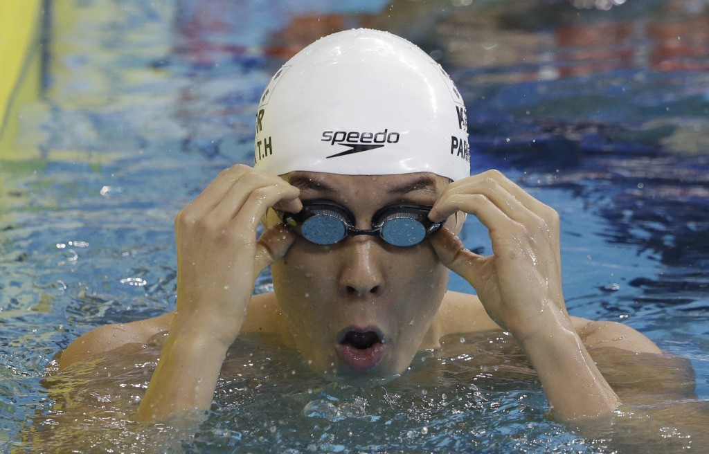 South Korea's Park Tae-hwan adjusts his goggles after competing a men's 200-meter freestyle swimming heat at the 17th Asian Games in Incheon, South Korea, Sunday, Sept. 21, 2014.  (AP Photo/Lee Jin-man)