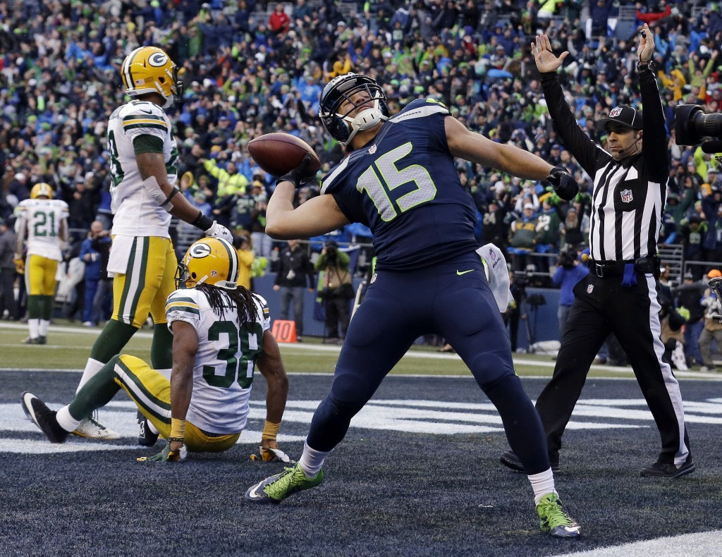 Seattle Seahawks' Jermaine Kearse celebrates after catching the game-winning touchdown during overtime of the NFL football NFC Championship game against the Green Bay Packers Sunday, Jan. 18, 2015, in Seattle. The Seahawks won 28-22 to advance to Super Bowl XLIX. (AP Photo/Jeff Chiu)