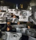 People from all over the world have shown support for the victims in France. Mourners hold signs depicting victim's eyes during a rally in support of Charlie Hebdo, a French satirical weekly newspaper that fell victim to an terrorist attack, Wednesday, Jan. 7, 2015, at Union Square in New York. French officials say 12 people were killed when masked gunmen stormed the Paris offices of the periodical that had caricatured the Prophet Muhammad. (AP Photo/John Minchillo)