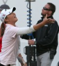 Lydia Ko, of New Zealand, tosses her ball to a fan after finishing the third round of the LPGA's Coates Golf Championship, Friday, Jan. 30, 2015, in Ocala, Fla. (AP Photo/The Star-Banner, Bruce Ackerman)