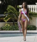 Miss Universe contestant Nia Sanchez, of the USA, walks along the pool during the Yamamay swimsuit runway show, Wednesday, Jan. 14, 2015, in Doral, Fla. The Miss Universe pageant will be held Jan. 25 in Miami. (AP Photo/Lynne Sladky)