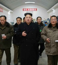 North Korean leader Kim Jong-un tours a precision machine factory in Pyongyang. North Korea's official Korean Central News Agency reported it on Jan. 16, 2015, without saying when the visit was made. (Yonhap)