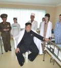 North Korean leader Kim Jong-un (C) tours a hospital specializing in the treatment of soldiers. Kim's wife Ri Sol-ju is at third from right. North Korea's official Korean Central News Agency reported it on May 19, 2014, without revealing the timing of the visit or the location of the venue. (Yonhap)