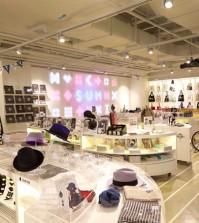 SUM, a celebrity shop on the second floor of SMTOWN@coexartium, carries souvenirs and fashion items that SM artists have designed or recommended. (Courtesy of SM Entertainment)