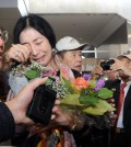 Shin Eun-mi, who was deported by Korean Immigration Services for holding an allegedly pro-North Korea lecture series, arrived in LAX Saturday. (Park Sang-hyuk/The Korea Times)