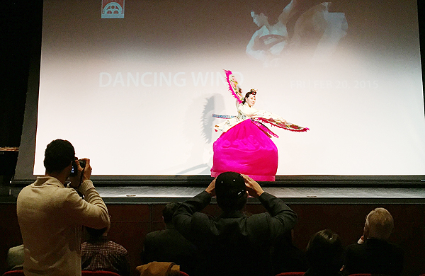 A dancer performs during a press conference about Lunar New Year Festival 2015 at Flushing Town Hall.