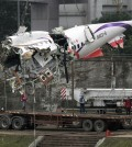 The main fuselage from TransAsia Airways Flight 235 is hoisted away in Taipei, Taiwan, Thursday, Feb. 5, 2015. The commercial plane crash with 58 people aboard clipped a bridge shortly after takeoff and crashed into a river in the island's capital of Taipei on Wednesday morning. (AP Photo/Wally Santana)
