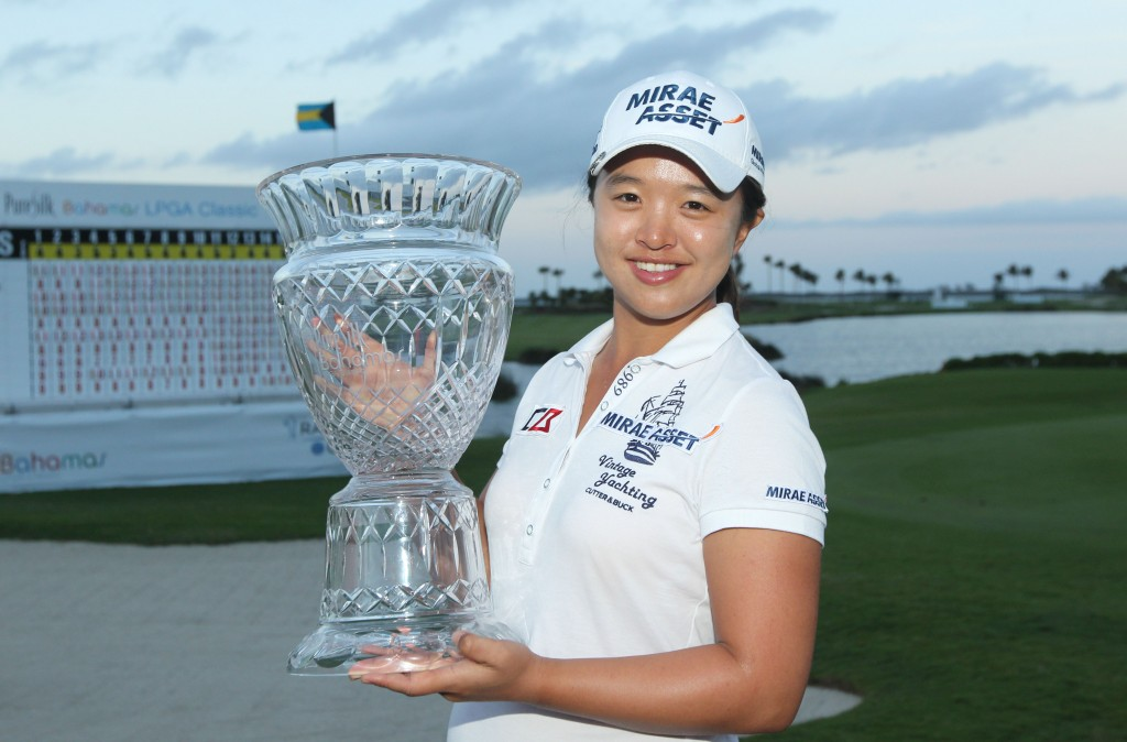 Sei Young Kim of South Korea holds her trophy after winning the Pure Silk Bahamas LPGA Classic at the Ocean Club Golf Course, in Paradise Island, Bahamas, Sunday, Feb 8, 2015. (AP Photo/Tim Aylen)