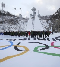 Participants attend an event marking the three-year countdown to the start of the 2018 Winter Olympics at Alpensia Ski Jumping Centre in Pyeongchang, South Korea, Monday, Feb. 9, 2015. The South Korean government recently rejected a proposal by the International Olympic Committee to halt construction on a new bobsled, luge and skeleton venue and relocate the events to an existing sliding center in another country. The IOC said the move would have saved $120 million in construction costs and $3.5 million in yearly maintenance fees.(AP Photo/Yonhap, Han Jong-chan)