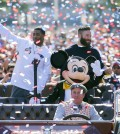 In this image provided by Disneyland, New England Patriots players Julian Edelman, right, and Malcolm Butler join Mickey Mouse as they celebrated their team's Super Bowl XLIX championship victory over the Seattle Seahawks at Disneyalnd park in Anaheim, Calif., on Monday, Feb. 2, 2015. (AP Photo/Disneyland, Paul Hiffmeyer)