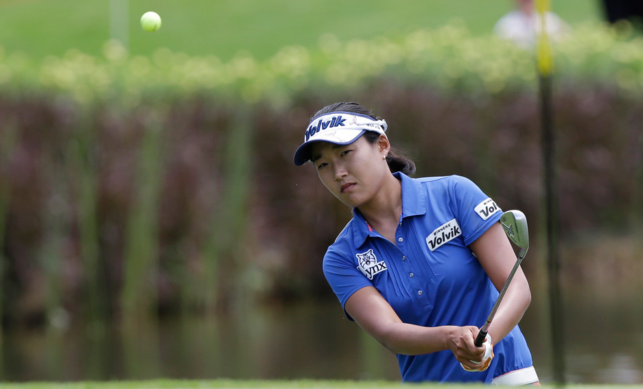 South Korea's Lee Ilhee stares down a chip shot on the ninth green. (AP Photo/Mark Baker)