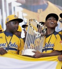 FILE - In this Aug. 27, 2014, file photo, members of the Jackie Robinson West Little League baseball team participate in a rally in Chicago celebrating the team's U.S. Little League Championship. Little League International has stripped Chicago's Jackie Robinson West team of its national title after finding the team falsified its boundary map. The league made the announcement Wednesday morning, Feb. 11, 2015, saying the Chicago team violated regulations by placing players on the team who didn't qualify because they lived outside the team's boundaries. Little League International also suspended Jackie Robinson West manager Darold Butler from league activity.(AP Photo/Charles Rex Arbogast, File)