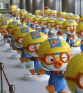 "Dolls featuring the globally popular Korean animation character ""Pororo"" are displayed at a character licensing show in Seoul on July 17, 2013. The TV animation series ""Pororo the Little Penguin"" debuted 10 years ago and has been exported to 120 countries around the world thus far. (Yonhap)"