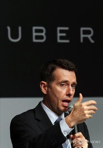 David Plouffe, the senior vice president of policy and strategy at Uber Technologies Inc., speaks at a press conference in Seoul on Feb. 4, 2015. (Yonhap)