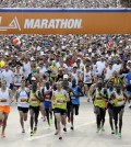 Runners take off from Dodger Stadium during the Los Angeles Marathon in Los Angeles, Sunday, March 9, 2014.  (AP Photo/Reed Saxon)