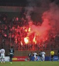 Soccer fans hold lit flares at the stand as they watch a match between Egyptian Premier League clubs Zamalek and ENPPI at Air Defense Stadium in a suburb east of Cairo, Egypt, Sunday, Feb. 8, 2015. A riot broke out Sunday night outside of the major soccer game, with a stampede and fighting between police and fans killing at least 22 people, authorities said. (AP Photo/Ahmed Abd El-Gwad, El Shorouk newspaper)