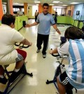 Puerto Rican children's fitness expert Jose Ortiz helps train overweight boys on stationary bikes inside the gym he operates in Guaynabo, Puerto Rico. Statistics point to a growing generation of Puerto Rican children struggling with obesity and related diseases, once rarely seen among such young people. (AP)