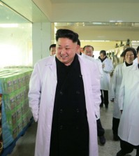 North Korean leader Kim Jong-un (L) tours a foodstuff factory in Pyongyang. North Korea's official Korean Central News Agency reported it on Jan. 19, 2015, without elaborating on the timing of the visit. (KCNA-Yonhap)