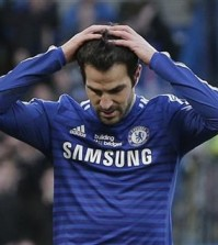 Chelsea's Cesc Fabregas reacts after missing a chance to score against Burnley during an English Premier League soccer match at the Stamford Bridge ground in London, Saturday, Feb. 21, 2015. The match ended 1-1 draw. (AP Photo/Lefteris Pitarakis)