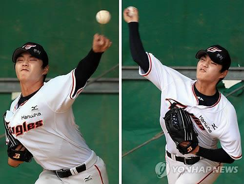 Choi Woo-seok of the Hanwha Eagles throws with both hands in the bullpen during the team's spring training in Japan on Feb. 27, 2015. (Yonhap file photo)