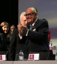 Former New York City Mayor Rudy Giuliani claps at the start of a day-long conference on human rights organized by the Iranian exile opposition group National Council of Resistance of Iran on Saturday, March 7, 2015. Giuliani was one of the main speakers. (AP Photo/Frank Jordans)