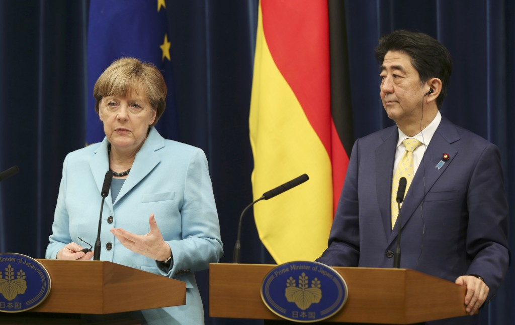 Germany's Chancellor Angela Merkel speaks during a joint press conference with Japanese Prime Minister Shinzo Abe at Prime Minister's official Residence in Tokyo, Monday, March 9, 2015. (AP Photo/Koji Sasahara)
