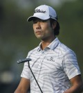 Kevin Na walks off the second green after putting during the first round of the Arnold Palmer Invitational golf tournament , Thursday, Mar. 19, 2015, in Orlando, Fla. (AP Photo/Reinhold Matay)