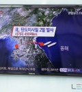 "A man watches a TV news program reporting on North Korea fired two short-range ballistic missiles into the sea two short-range ballistic missiles into the sea, at Seoul Railway Station in Seoul, South Korea, Monday, March 2, 2015. North Korea on Monday fired two short-range ballistic missiles into the sea and warned of ""merciless strikes"" against its enemies as allies Seoul and Washington launched annual military drills Pyongyang claims are preparation for a northward invasion. The letters read ""North Korea, fired two short-range ballistic missiles."" (AP Photo/Lee Jin-man)"