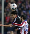 Leverkusen's Son Heung-min, left and Atletico's Juanfran hump for a high ball during the Champions League round of sixteen second leg soccer match between Atletico de Madrid and Bayer 04 Leverkusen at the Vicente Calderon stadium in Madrid, Spain, Tuesday, March 17, 2015. (AP Photo/Andres Kudacki)