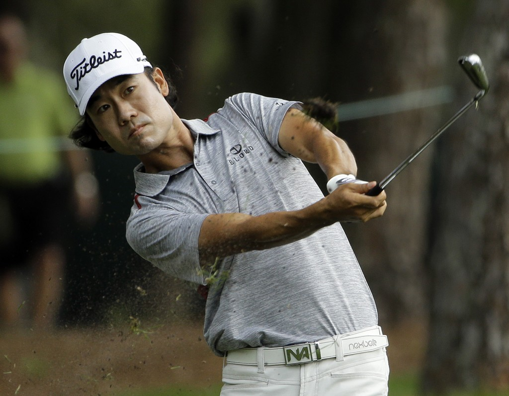 Kevin Na hits from the rough along the 11th hole during the first round of the Valspar Championship golf tournament, Thursday, March 12, 2015, at Innisbrook in Palm Harbor, Fla. (AP Photo/Chris O'Meara)
