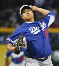 Los Angeles Dodgers starting pitcher Hyun-Jin Ryu throws against the San Diego Padres during a spring training baseball game Thursday, March 12, 2015, in Peoria, Ariz.  (AP Photo/Lenny Ignelzi)